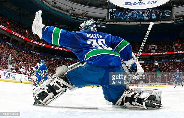 Ryan Miller of the Vancouver Canucks makes a glove save against the Anaheim Ducks during their NHL game at Rogers Arena February 18 2016 in Vancouver...