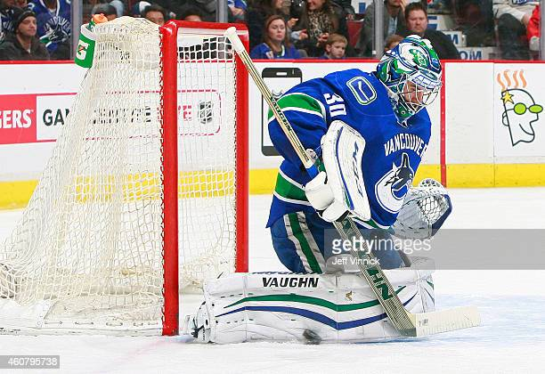Ryan Miller of the Vancouver Canucks makes a save against the Arizona Coyotes during their NHL game at Rogers Arena December 22 2014 in Vancouver...