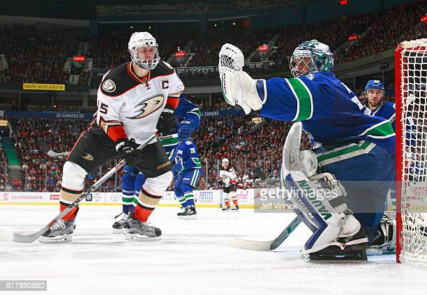 Ryan Miller of the Vancouver Canucks makes a save off the shot of Ryan Getzlaf of the Anaheim Ducks during their NHL game at Rogers Arena February 18...