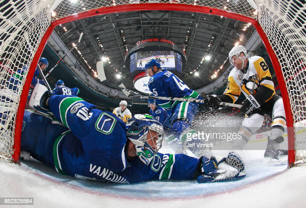 Ryan Miller of the Vancouver Canucks makes a save off the shot of Phil Kessel of the Pittsburgh Penguins during their NHL game at Rogers Arena March...