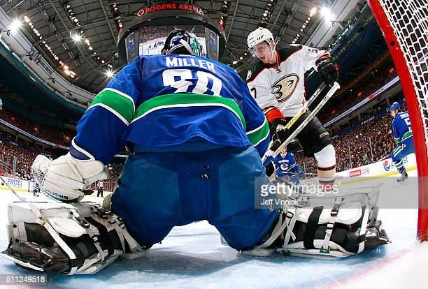 Ryan Miller of the Vancouver Canucks makes a save on David Perron of the Anaheim Ducks during their NHL game at Rogers Arena February 18 2016 in...