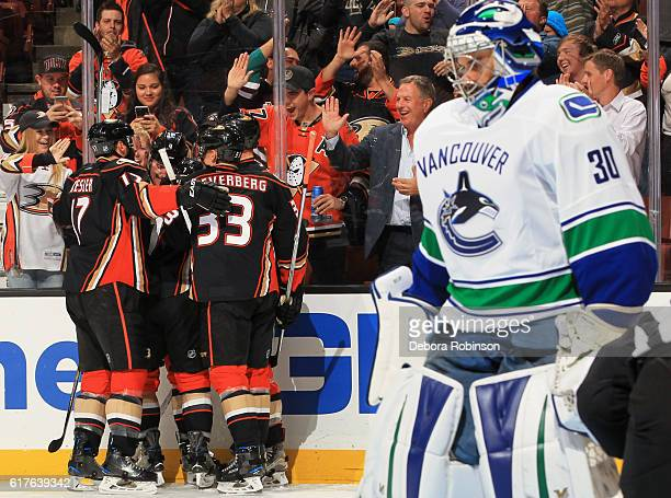 Ryan Miller of the Vancouver Canucks reacts as Ryan Kesler and Jakob Silfverberg of the Anaheim Ducks celebrate a first period goal on October 23...