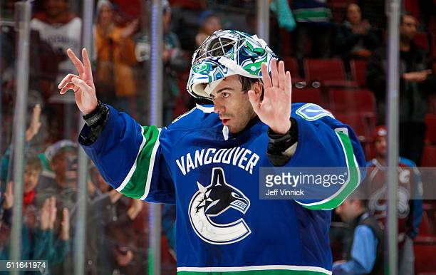 Ryan Miller of the Vancouver Canucks salutes the fans after beinbg named the first star against the Colorado Avalanche during their NHL game at...