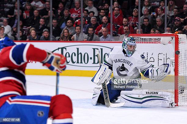 Ryan Miller of the Vancouver Canucks watches the rebounding puck on a shot by Max Pacioretty of the Montreal Canadiens during the NHL game at the...