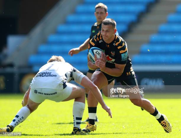 Ryan Mills of Wasps is tackled by Dan Thomas tackles during the Gallagher Premiership Rugby match between Wasps and Bristol Bears at the Ricoh Arena...