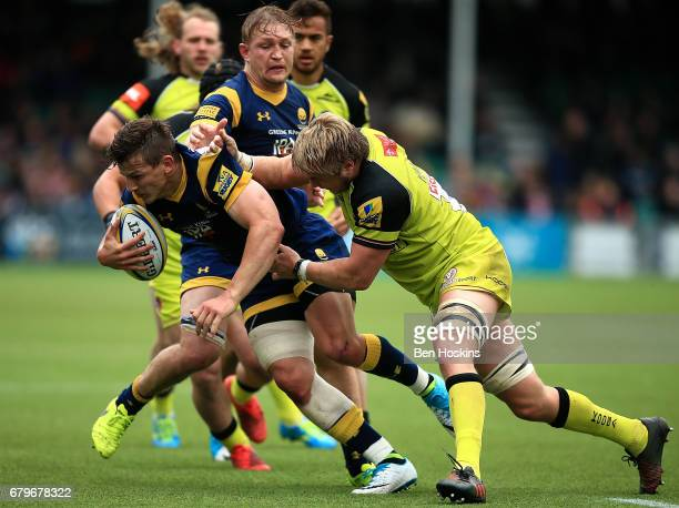 Ryan Mills of Worcester is tackled by Luke Hamilton of Leicester during the Aviva Premiership match between Worcester Warriors and Leicester Tigers...
