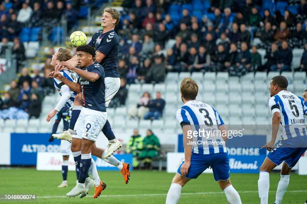 Ryan Mmaee of AGF Arhus and Jens Stage of AGF Arhus compete for the ball during the Danish Superliga match between OB Odense and AGF Arhus at Nature...