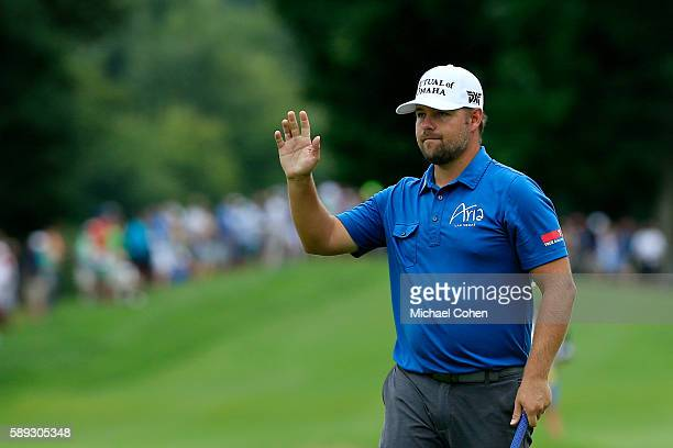 Ryan Moore acknowledges the crowd after his birdie on the 17th hole during the continuation of the second round of the John Deere Classic at TPC...