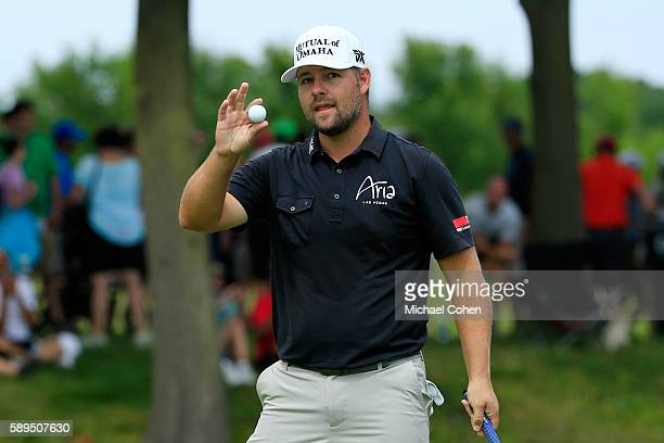 Ryan Moore acknowledges the crowd after his birdie on the tenth hole during the final round of the John Deere Classic at TPC Deere Run on August 14...