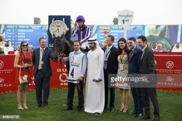 Ryan Moore Aidan O'Brien and Mendelssohn's connections celebrate after winning the UAE Derby during the Dubai World Cup Day at Meydan Racecourse on...