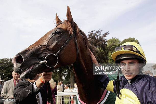 Ryan Moore and Notnowcato after landing The Juddmonte International Stakes Race run at York Racecourse on August 22 2006 in York England The race was...