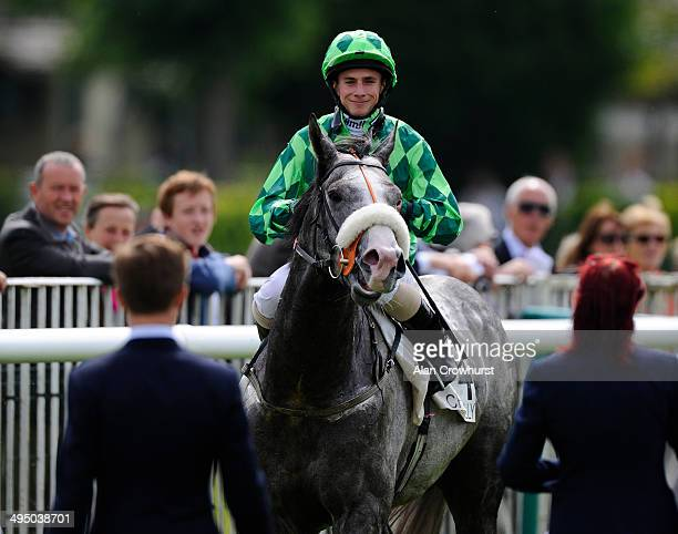 Ryan Moore and The Grey Gatsby win The Prix Du Jockey Club at Chantilly racecourse on June 01 2014 in Chantilly France