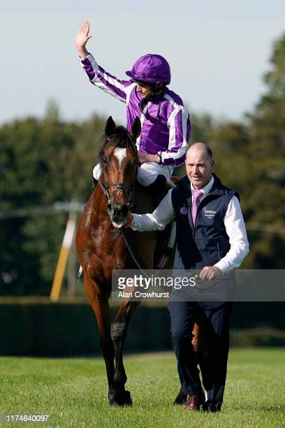 Ryan Moore celebrates after riding Magical to win The Qipco Irish Champion Stakes at Leopardstown Racecourse on Irish Champion Stakes Day on...