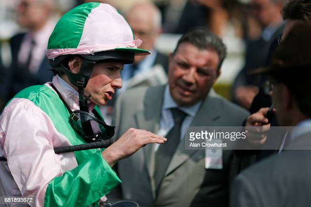 Ryan Moore chats with connections after riding Deauville to win The sportingbetcom Huxley Stakes at Chester Racecourse on May 11 2017 in Chester...