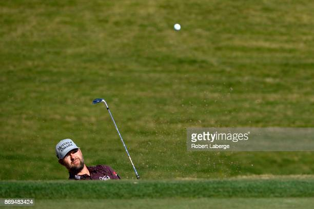 Ryan Moore hits from a green side bunker on the third hole during the first round of the Shriners Hospitals For Children Open at TPC Summerlin on...