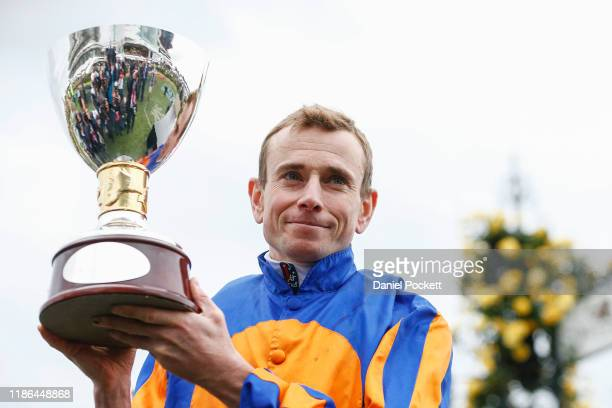 Ryan Moore holds the trophy after winning race 8 the Seppelt Mackinnon Stakes during 2019 Stakes Day at Flemington Racecourse on November 09 2019 in...