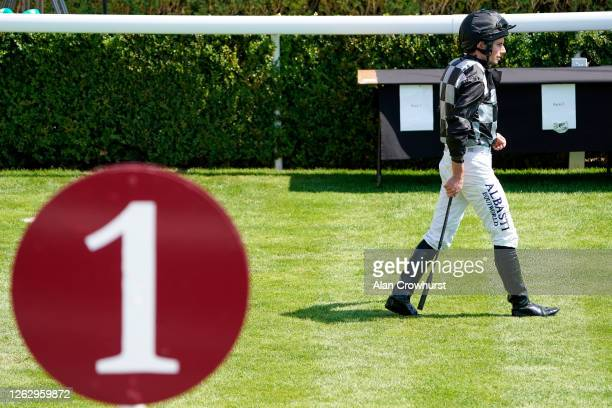 Ryan Moore make his way to the parade ring at Goodwood Racecourse on July 31 2020 in Chichester England Owners are allowed to attend if they have a...