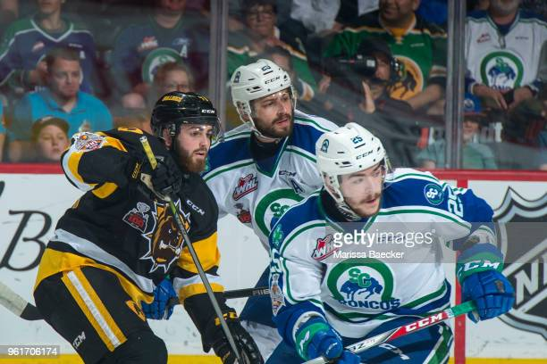 Ryan Moore of Hamilton Bulldogs is checked by Giorgio Estephan and Tanner Nagel of Swift Current Broncos at Brandt Centre Evraz Place on May 21 2018...