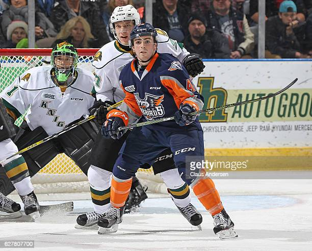 Ryan Moore of the Flint Firebirds looks for a shot to tip in front of Robert Thomas of the London Knights during an OHL game at Budweiser Gardens on...