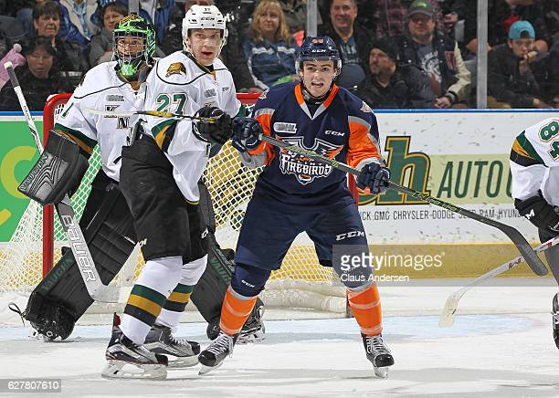 Ryan Moore of the Flint Firebirds skates against Robert Thomas of the London Knights during an OHL game at Budweiser Gardens on December 4 2016 in...