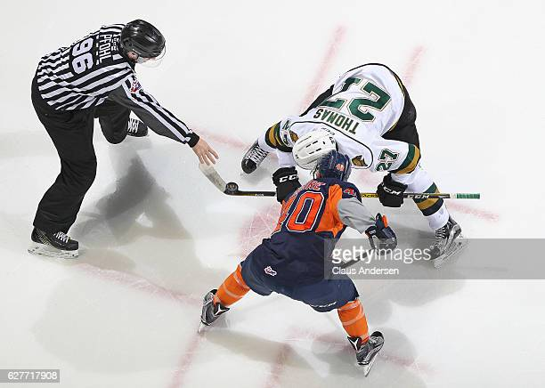 Ryan Moore of the Flint Firebirds takes a faceoff against Robert Thomas of the London Knights during an OHL game at Budweiser Gardens on December 4...
