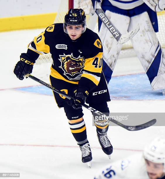 Ryan Moore of the Hamilton Bulldogs skates up ice against the Mississauga Steelheads during game action on December 10 2017 at Hershey Centre in...