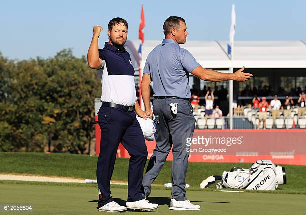 Ryan Moore of the United States celebrates on the 18th green after winning his match and the Ryder Cup against Lee Westwood of Europe during singles...