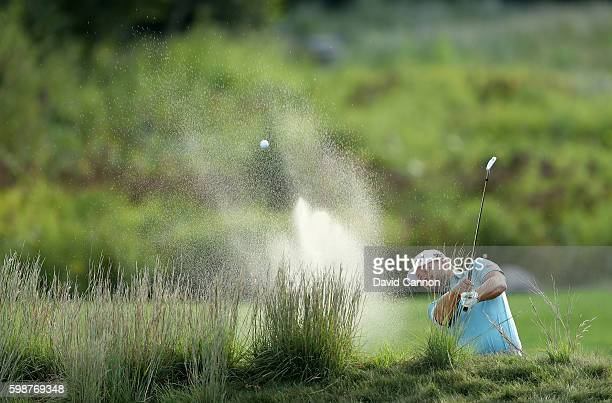 Ryan Moore of the United States plays his second shot on the 18th hole during the first round of the Deutsche Bank Championship at TPC Boston on...