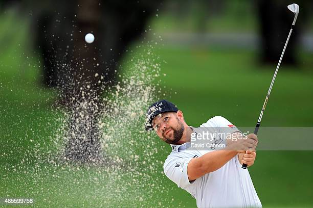 Ryan Moore of the United States plays his third shot on the sixth hole during the final round of the World Golf ChampionshipsCadillac Championship at...
