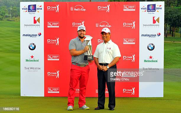 Ryan Moore of the United States poses for photographs with the Deputy Prime Minister of Malaysia Tan Sri Muhyiddin Yassin after the playoff with Gary...
