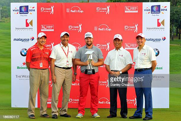 Ryan Moore of the United States poses for photographs with the Deputy Prime Minister of Malaysia Tan Sri Muhyiddin Yassin and Officials after the...