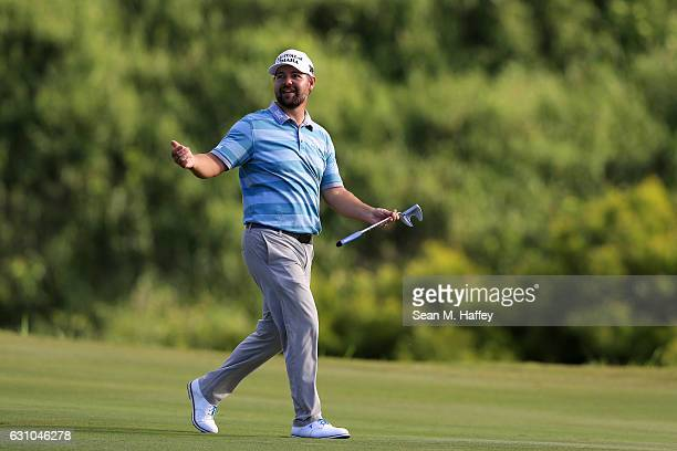 Ryan Moore of the United States reacts on the 17th hole during the first round of the SBS Tournament of Champions at the Plantation Course at Kapalua...