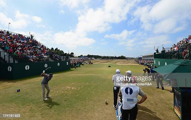 Ryan Moore of the United States tees off on the first hole during the final round of the 142nd Open Championship at Muirfield on July 21 2013 in...