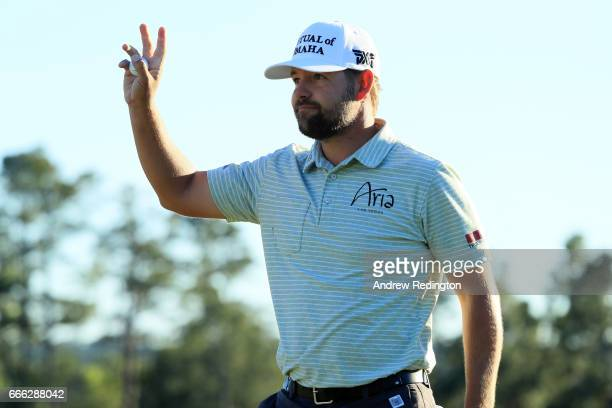 Ryan Moore of the United States waves after making par on the 18th hole during the third round of the 2017 Masters Tournament at Augusta National...