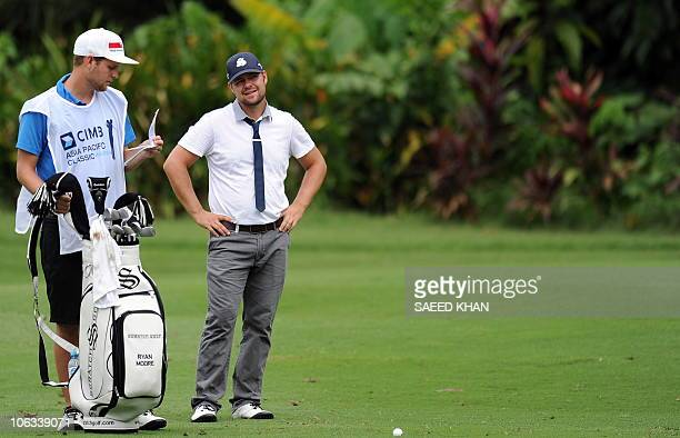 Ryan Moore of the US examines the direction before playing a shot on the 1st hole during the second round of the CIMB Asia Pacific Classic Malaysia...