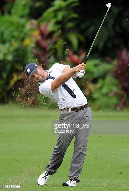 Ryan Moore of the US hits a shot towards the 1st green during the second round of the CIMB Asia Pacific Classic Malaysia 2010 golf tournament in...
