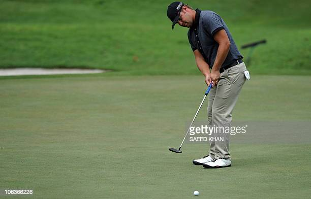 Ryan Moore of the US putts on the 10th green during the third round of the CIMB Asia Pacific Classic Malaysia 2010 golf tournament in Kuala Lumpur on...