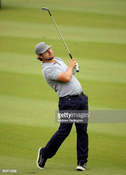 Ryan Moore of the USA hits his second shot on the seventh hole during the third round of the WGCHSBC Champions at Sheshan International Golf Club on...