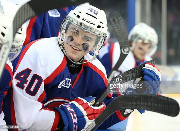 Ryan Moore of the Windsor Spitfires watches from the bench against the Saginaw Spirit during Game One of the OHL Winter Classic at Comerica Park on...