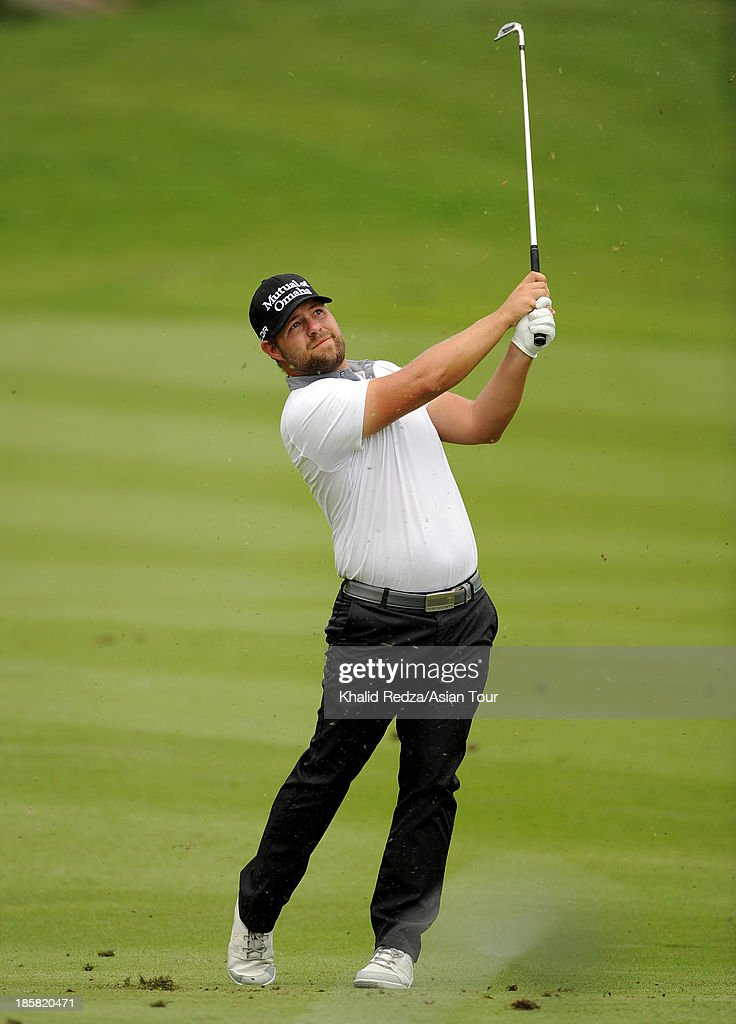 Ryan Moore of USA plays a shot during round two of the CIMB Classic at Kuala Lumpur Golf & Country Club on October 25, 2013 in Kuala Lumpur, Malaysia.