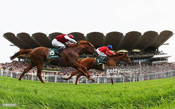 Ryan Moore on Allegretto takes the lead to win from Philip Robinson on Veracity in the ABN Amro Goowwood Cup run at Goodwood Racecourse on August 2...