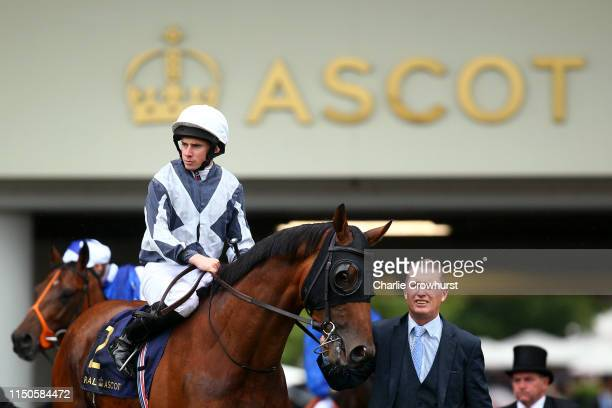 Ryan Moore on Circus Maximus comes out onto the track ahead of his win in The St James's Palace Stakes during day one of Royal Ascot at Ascot...