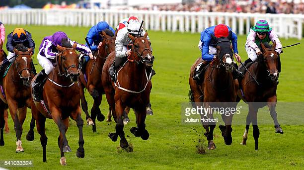 Ryan Moore on Sir Issac Newton leads the field home to win The Wolferton Handicap Stakes Race run during Day Five of Royal Ascot at Ascot Racecourse...