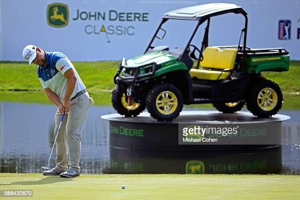 Ryan Moore plays his shot on the 18th green during the first round of the John Deere Classic at TPC Deere Run on August 11 2016 in Silvis Illinois