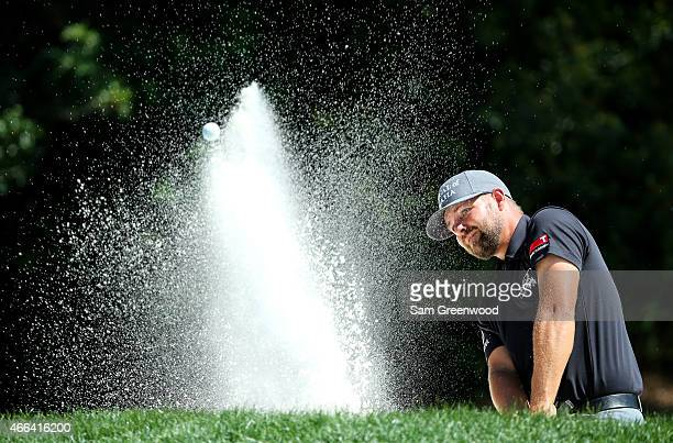 Ryan Moore plays out of a bunker on the second hole during the final round of the Valspar Championship at Innisbrook Resort Copperhead Course on...