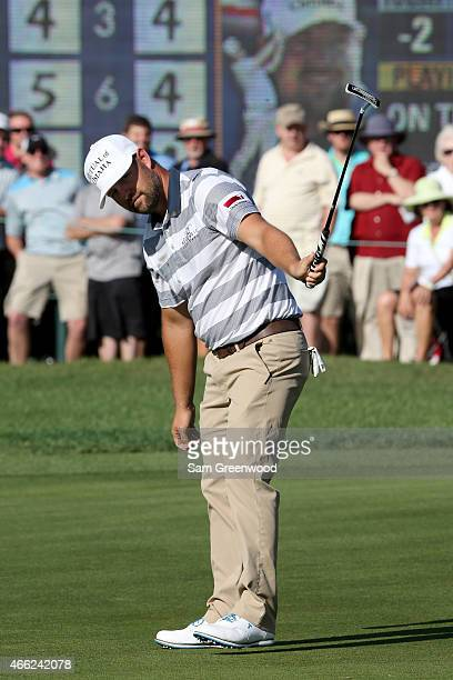 Ryan Moore reacts to a birdie putt on the 16th green during the third round of the Valspar Championship at Innisbrook Resort Copperhead Course on...