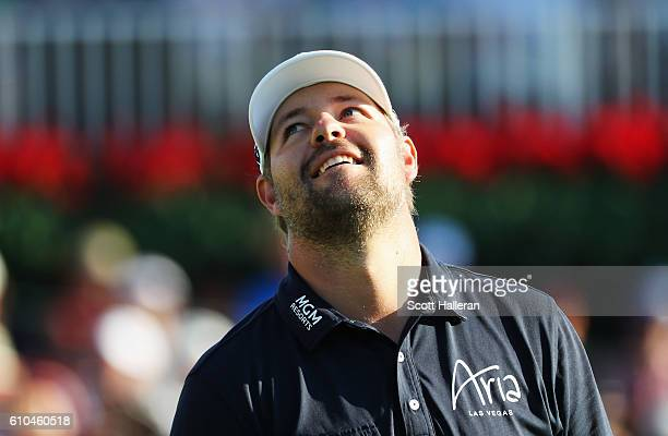 Ryan Moore reacts to a missed birdie putt on the 18th green during the final round of the TOUR Championship at East Lake Golf Club on September 25...