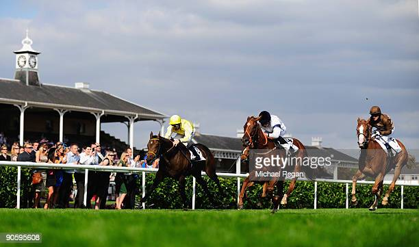 Ryan Moore rides Pollenator to victory during the DFS May Hill Stakes at Doncaster Racecourse on September 11, 2009 in Doncaster, England.