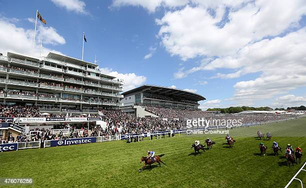 Ryan Moore rides Stravagante to win The Investec Private Banking Stakes at Epsom racecourse on June 06 2015 in Epsom England