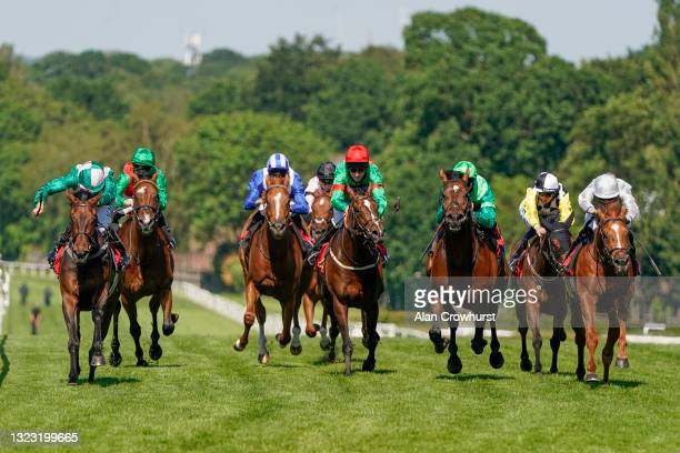 Ryan Moore riding Betty Crean L A win The Coral Proud Supporter Of British Racing EBF Maiden Stakes at Sandown Park Racecourse on June 12, 2021 in...
